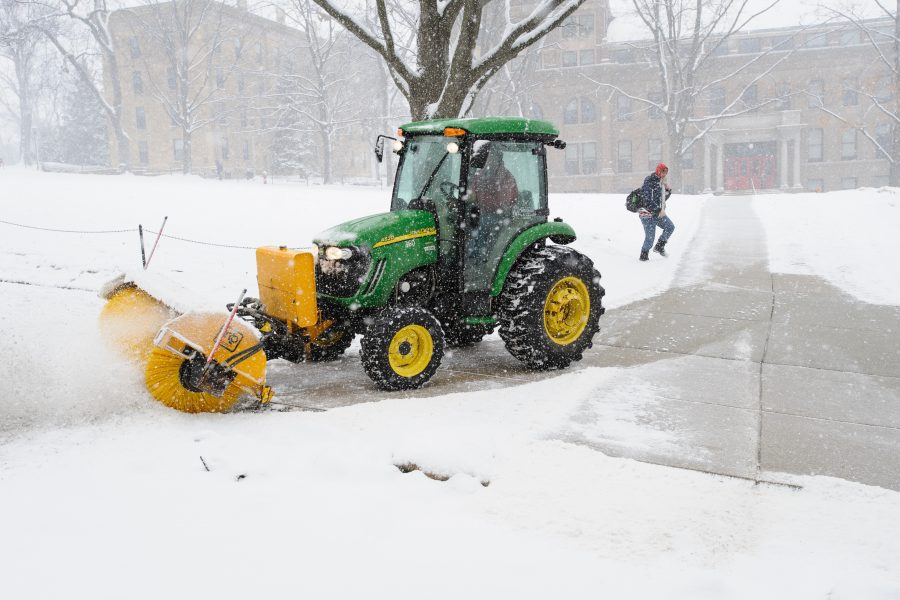 campus tractor clearing sidewalks on Bascom Hill